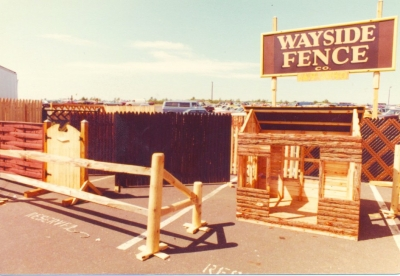 The West Babylon, NY yard featuring dog houses, wood and slatted chain link fences: 1981